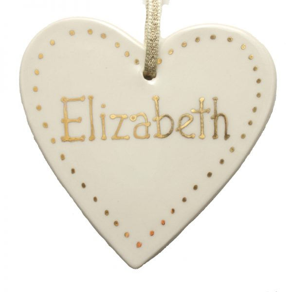Personalised gold heart decoration.
