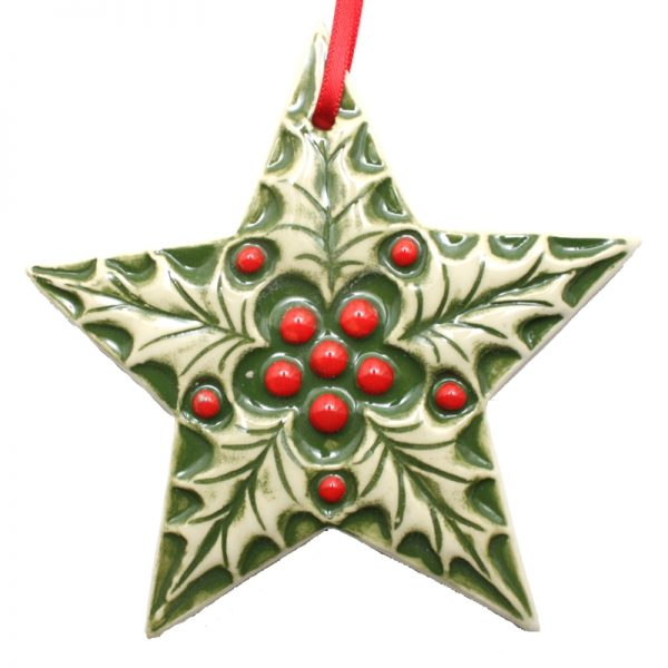 A Christmas tree decoration with holly leaves and berries